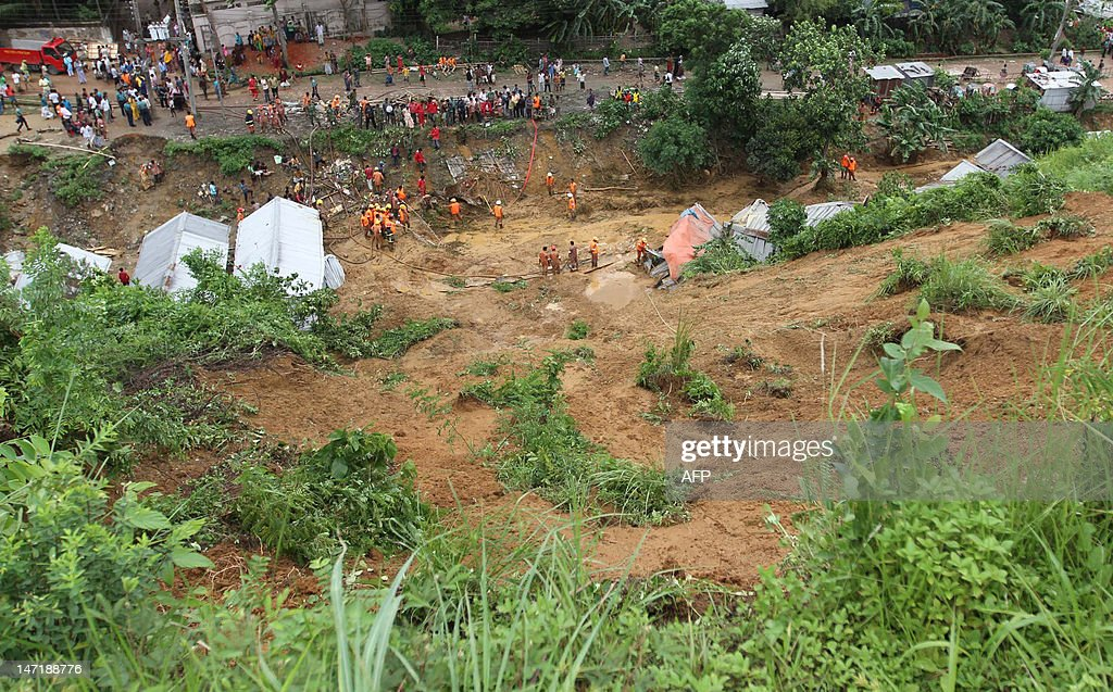 Bangladeshi fire fighters search for bodies after a landslide in Chittagong on June 27, 2012. Nearly 90 people have been killed in landslides in southeast Bangladesh after three days of rains that triggered flash floods and severed transport links, officials said.