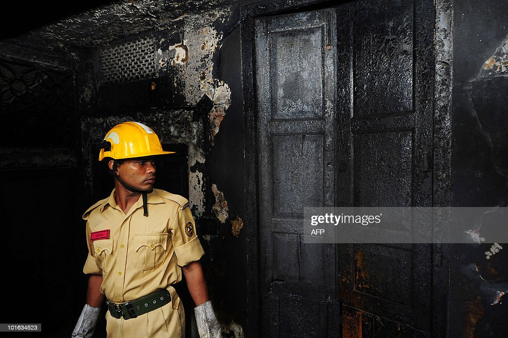 A Bangladeshi firefighter inspects the site of a burnt-out house in Old Dhaka on June 5, 2010. The national flag flew at half-mast and people of all faiths joined prayers as Bangladesh mourned the deaths of nearly 120 people in the country's deadliest blaze.
