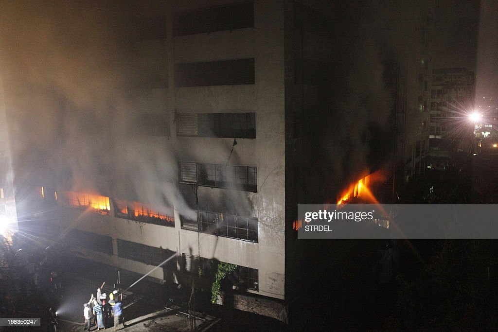Bangladeshi firefighters attempt to extinguish a blaze at a garment factory in Dhaka early on May 9, 2013. A fire at a garment factory killed at least eight people May 9 in the latest disaster to hit Bangladesh's textile industry, still reeling from the deaths of more than 900 people in a building collapse.