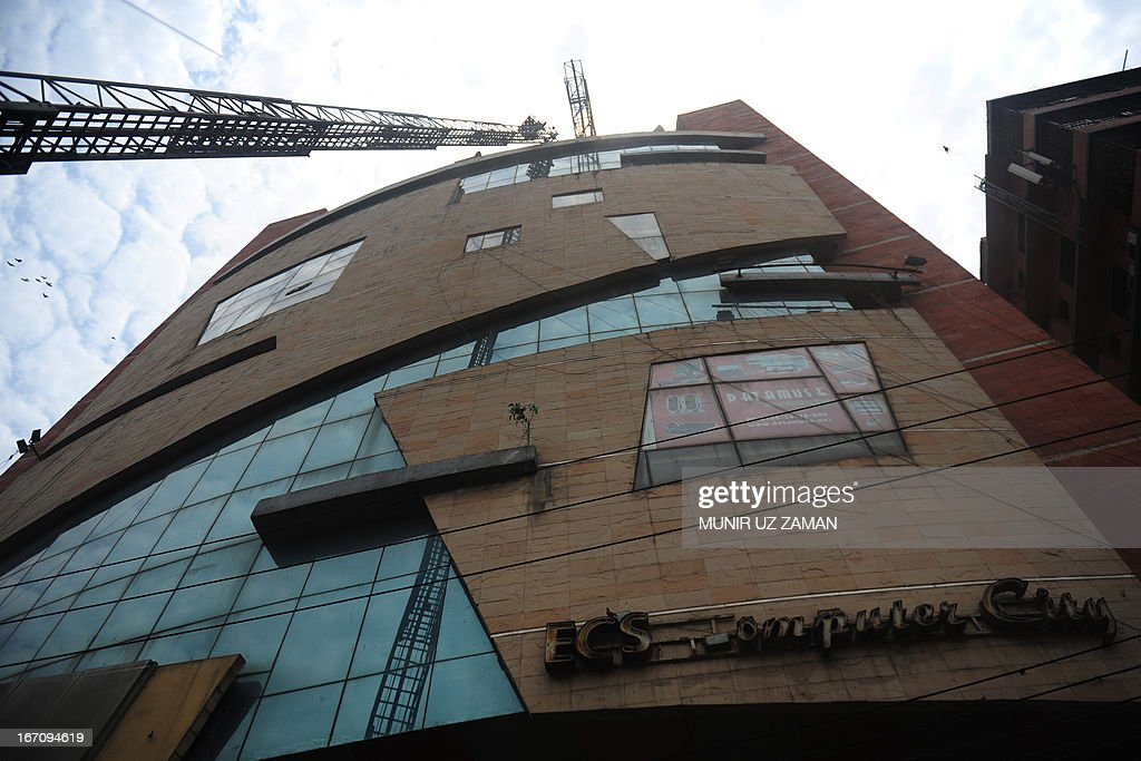 Bangladeshi firefighters attempt to extinguish a blaze at a shopping centre in Dhaka on April 20, 2013. At least 12 fire fighting units rushed to the spot to control the blaze. AFP PHOTO/ Munir uz ZAMAN