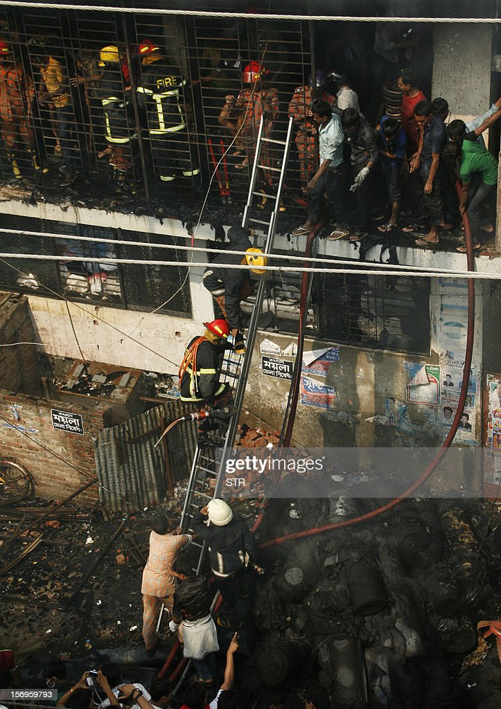Bangladeshi firefighters climb a ladder as they try and control a fire that broke out at a garment factory on the outskirts of Dhaka on November 26, 2012. Bangladesh firefighters quelled a new blaze at a garment factory as the country mourned the death of 110 workers in a weekend blaze at an apparel plant, the export industry's worst-ever accident. The latest fire caused widespread damage at the plant on the outskirts of the capital Dhaka, but no casualties were reported after rescue teams searched the building for workers feared to have suffocated in toxic black fumes.