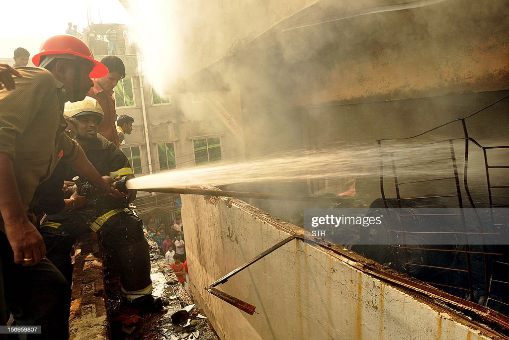 Bangladeshi firefighters try and control a fire that broke out at a garment factory on the outskirts of Dhaka on November 26, 2012. Bangladesh firefighters quelled a new blaze at a garment factory as the country mourned the death of 110 workers in a weekend blaze at an apparel plant, the export industry's worst-ever accident. The latest fire caused widespread damage at the plant on the outskirts of the capital Dhaka, but no casualties were reported after rescue teams searched the building for workers feared to have suffocated in toxic black fumes. AFP PHOTO/ STR