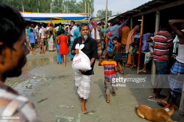 Bangladeshi flood affected men receive relief from a local rulling party MP at Jamtola Sariakandi Bogra Bangladesh 17 August 2017 According to...