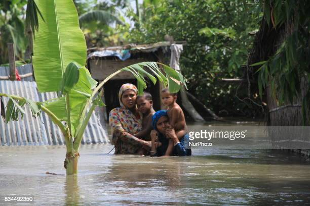 Bangladeshi flood victims are looking for relief materials in Kurigram northern Bangladesh on August 16 2017 More than 50 people have died in flood...