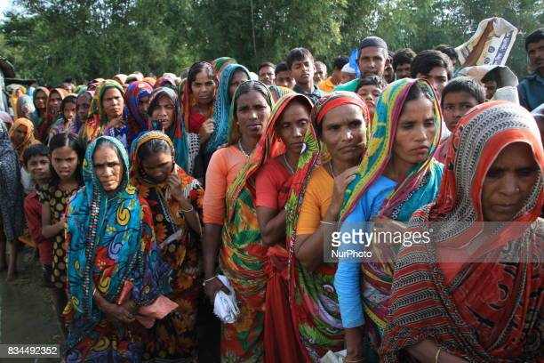 Bangladeshi flood victims are waiting for relief goods in Kurigram northern Bangladesh on August 16 2017 More than 50 people have died in flood and...