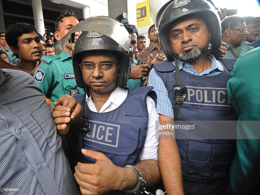 Bangladeshi garment factory owners Aminul Islam (L) and Masudur Rahaman (R), clad in police-issue body armour and helmet, are escorted for their appearance at the High Court in Dhaka on April 30, 2013. Bangladesh defended Tuesday its decision to snub foreign aid after the collapse of a garment factory complex where at least 388 people died as the UN revealed it had offered specialist help to find survivors.