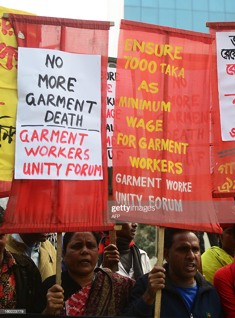 Bangladeshi garment workers and activists stage a protest in front of the Bangladesh Garment Manufactures & Exporters Association (BGMEA) office in Dhaka on January 28, 2013. Garment workers demanded an increase to their wages and an improvement in their work environment. Around 700 people have been killed in garment factory fires in the country since 2006. AFP PHOTO/ Munir uz ZAMAN