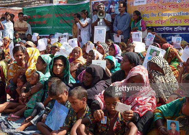 Bangladeshi garment workers demonstrate at the site of the Rana Plaza garment factory building collapse in Savar the outskirts of Dhaka on the...
