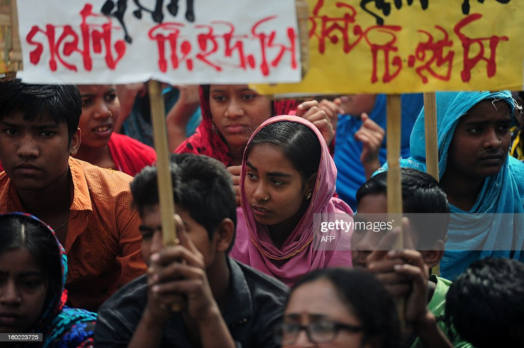 Bangladeshi garments workers and activists stage a protest in front of the Bangladesh Garment Manufactures & Exporters Association (BGMEA) office in Dhaka on January 28, 2013. Garment workers demanded an increase to their wages and an improvement in their work environment. Around 700 people have been killed in garment factory fires in the country since 2006. AFP PHOTO/ Munir uz ZAMAN