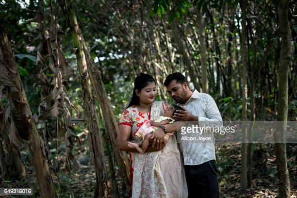 Meghla poses for a photo with her baby and her husband Liton on March 7 2017 in Khulna division Bangladesh 17yearold Meghla married her 30yearold...