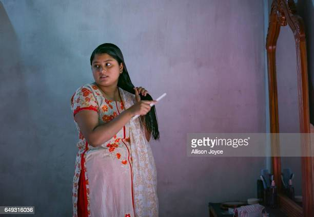 Meghla does her hair on March 7 2017 in Khulna division Bangladesh 17yearold Meghla married her 30yearold husband Liton during an arranged marriage...