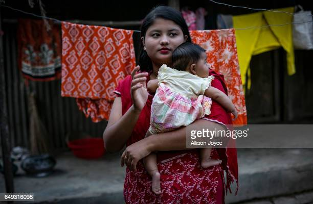 Meghla holds her baby on March 7 2017 in Khulna division Bangladesh 17yearold Meghla married her 30yearold husband Liton during an arranged marriage...