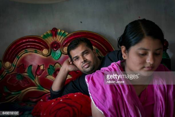 Meghla sits with her husband Liton on March 7 2017 in Khulna division Bangladesh 17yearold Meghla married her 30yearold husband Liton during an...