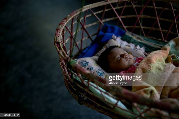 Meghla's 2 month old baby sleeps on March 7 2017 in Khulna division Bangladesh 17yearold Meghla married her 30yearold husband Liton during an...