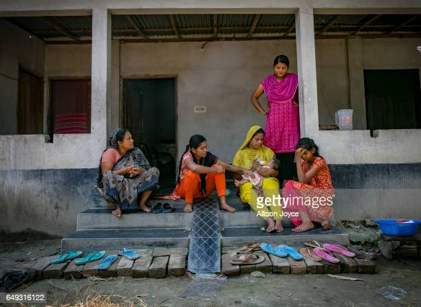 Meghla looks on as her mother feeds her baby while her sisters and grandmother look on on March 7 2017 in Khulna division Bangladesh 17yearold Meghla...