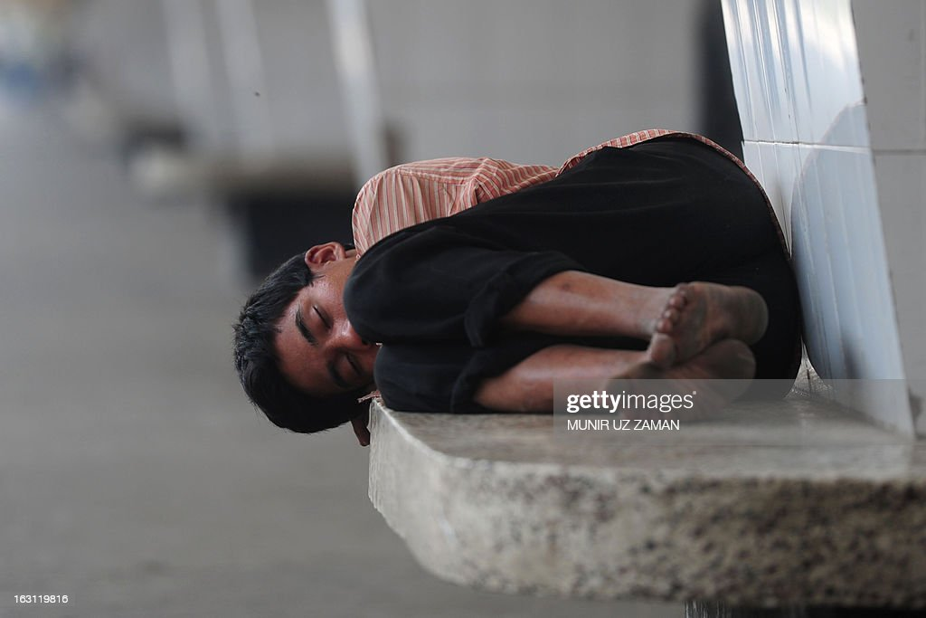 A Bangladeshi homeless man sleeps at the Kamalapur Railway Station during a nationwide strike called by the main opposition Bangladesh Nationalist Party, in Dhaka on March 5, 2013. Bangladesh police fired rubber bullets and tear gas at the supporters of the main opposition in Dhaka and two districts just outside the capital as the country was hit by a third day of strike over the worst political violence since independence. AFP PHOTO/Munir uz ZAMAN
