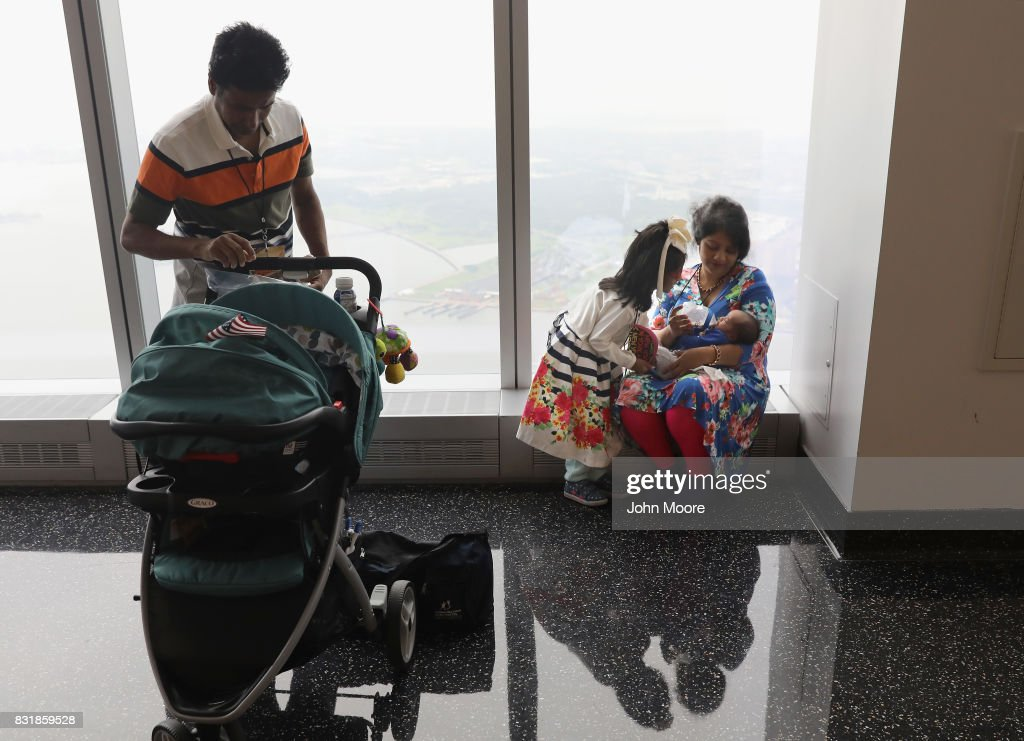 Bangladeshi immigrant Khadijatul Rahman, 29, feeds her baby boy Zavyaan, 2 weeks, after becoming a U.S. citizen at a naturalization ceremony held atop the One World Trade Center on August 15, 2017 in New York City. Thirty immigrants took the oath of citizenship to become American citizens at Manhattan's One World Trade Center, which at 1,776 feet high is the tallest building in the Western Hemishere.