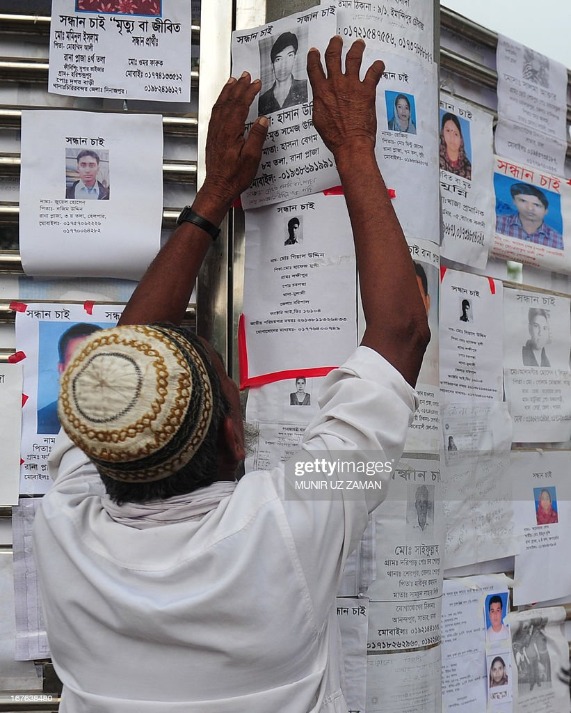 Bangladeshi man puts up a notice of a missing family member three days after an eight-storey building collapsed in Savar, on the outskirts of Dhaka, on April 27, 2013. Police arrested two textile bosses over a Bangladeshi factory disaster as the death toll climbed to 332 and distraught relatives lashed out at rescuers trying to detect signs of life. AFP PHOTO/ Munir uz ZAMAN