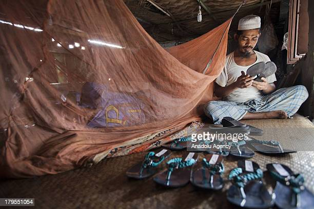 Bangladeshi man works in a recycling facility on May 30 2013 in Dhaka Bangladesh Recycling workers in Bangladesh one of the world's poorest countries...