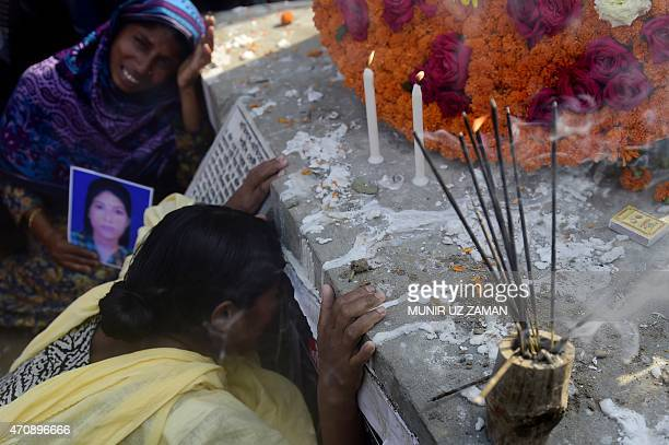 Bangladeshi mourners and relatives of a victim of the Rana Plaza building collapse weep as they mark the second anniversary of the disaster at the...