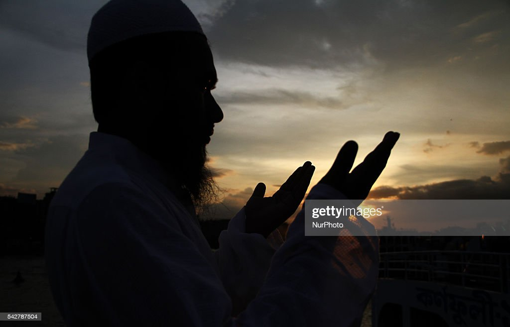 A Bangladeshi Muslim offer prayers before fast-breaking dinner during the Islamic holy month of Ramadan at a ferry station in Dhaka, Bangladesh on June24, 2016. Muslims around the world are observing the holy fasting month of Ramadan, celebrated with prayers, readings from the Koran, and gatherings with family and friends as they abstain from eating, drinking, smoking and sexual relations from dawn till dusk.