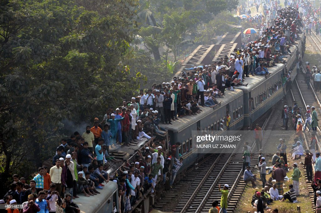 Bangladeshi Muslims arrive on an overcrowded train to attend the Biswa Ijtema or World Muslim Congregation at Tongi, about 30 kms north of Dhaka on January 26, 2014. Muslims joined in prayer on the banks of a river in Bangladesh as the world's second largest annual Islamic congregation ended. AFP PHOTO/ Munir uz ZAMAN