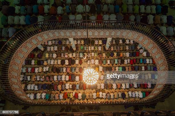 TOPSHOT Bangladeshi Muslims attend Eid alAdha prayers at Baitul Mukarrom National Mosque in Dhaka on September 13 2016 Muslims across the world...