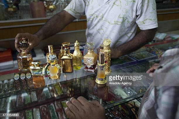 Bangladeshi muslims buy perfume ahead of Ramadan in Dhaka Bangladesh on June 16 2015