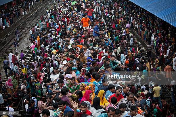 Bangladeshi Muslims crowd onto a train to head home to their respective villages ahead of Eid AlFitr July 17 2015 in Dhaka Bangladesh The Eid AlFitr...