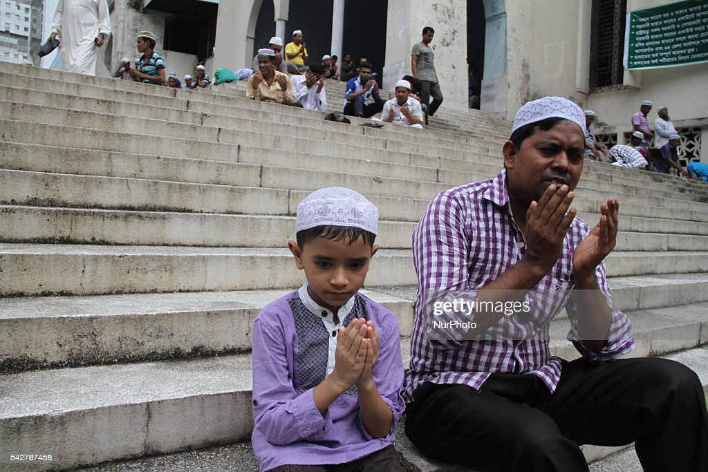 Bangladeshi Muslims offer Friday prayers as Ramadan continues at a National mosque in Dhaka on June 24, 2016. Muslims around the world are observing the holy fasting month of Ramadan, celebrated with prayers, readings from the Koran, and gatherings with family and friends as they abstain from eating, drinking, smoking and sexual relations from dawn till dusk.