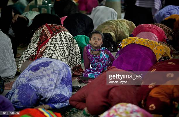Bangladeshi Muslims pray at Baitul Mukarram the National Mosque on Eid AlFitr July 18 2015 in Dhaka Bangladesh Muslims around the world are...