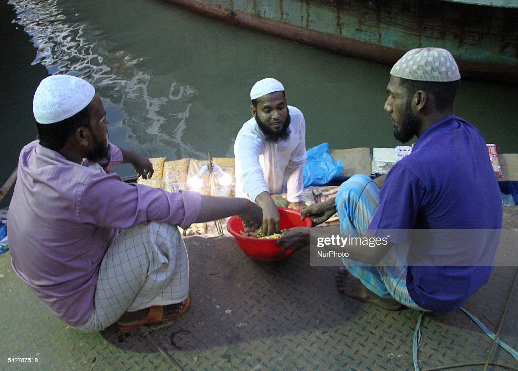 Bangladeshi Muslims taking fast-breaking dinner during the Islamic holy month of Ramadan at a ferry station in Dhaka, Bangladesh on June24, 2016. Muslims around the world are observing the holy fasting month of Ramadan, celebrated with prayers, readings from the Koran, and gatherings with family and friends as they abstain from eating, drinking, smoking and sexual relations from dawn till dusk.