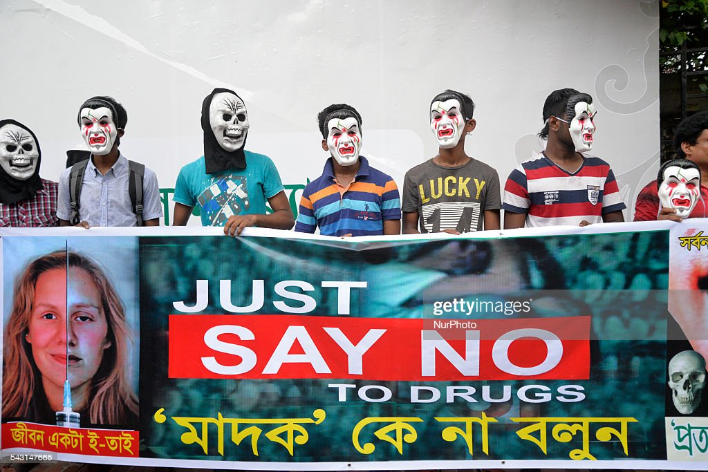 Bangladeshi non-governmental organization activists with mask held a Human chain to mark International Day against Drug Abuse and Illicit Trafficking in front of the National press club in Dhaka on June 26, 2015. International Day against Drug Abuse and Illicit Trafficking was established by the United Nations General Assembly in 1987 and is marked annually on June 26.