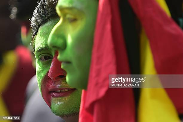 Bangladeshi participants their faces painted in the colours of their national flag take part in a rally to mark the country's 43rd Victory Day in...