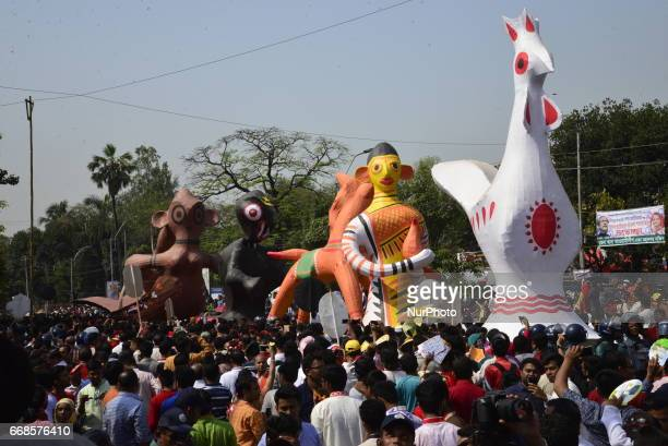 Bangladeshi people participate in a parade to celebrate the first day of the Bangla New Year or quotPahela Baisshakhquot in Dhaka Bangladesh Friday...