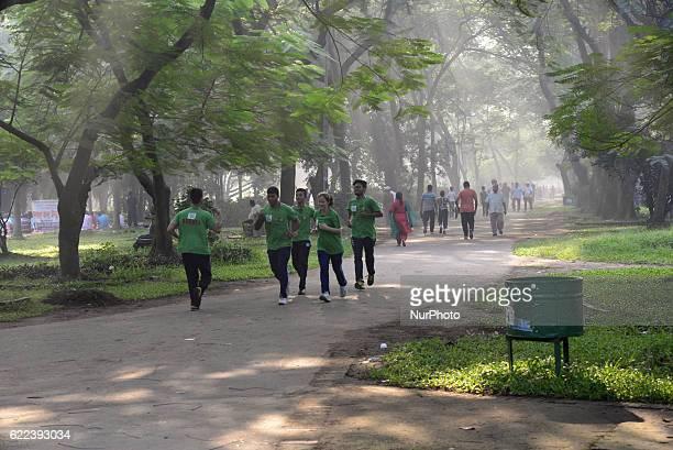 Bangladeshi Peoples are walking for good health at winter morning in the Ramna Park in Dhaka Bangladesh on November 11 2016