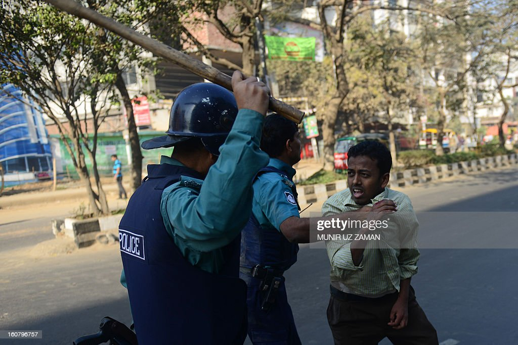 Bangladeshi police charge a suspected Bangladesh Jamaat-e-Islami activist during a nationwide strike in Dhaka on February 6, 2013. Police fired rubber bullets Wednesday at hundreds of activists from Bangladesh's largest Islamic party during a second day of rioting sparked by the conviction of a top opposition figure for war crimes. AFP PHOTO/ Munir uz ZAMAN
