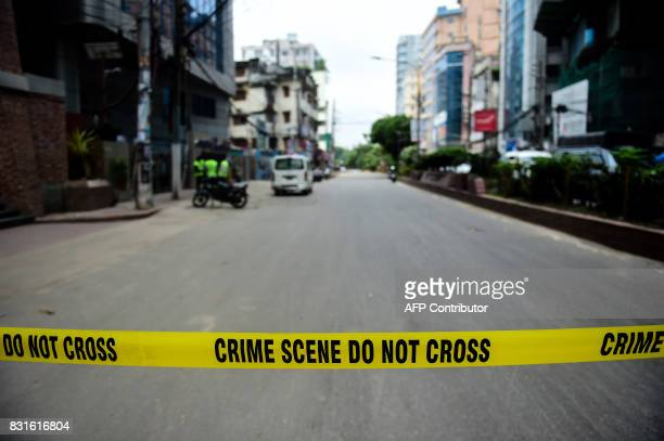 A Bangladeshi police crime scene notice is place around the area after a raid on a militant hideout in Dhaka on August 15 2017 An Islamist extremist...