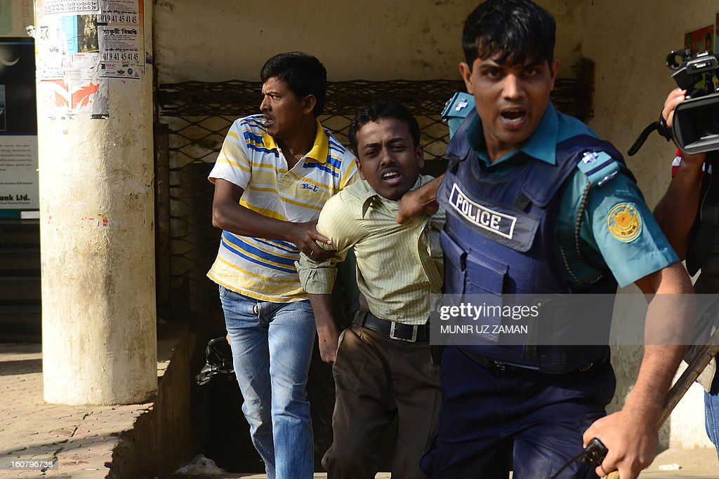 Bangladeshi police detain a suspected Bangladesh Jamaat-e-Islami activist during a nationwide strike in Dhaka on February 6, 2013. Police fired rubber bullets Wednesday at hundreds of activists from Bangladesh's largest Islamic party during a second day of rioting sparked by the conviction of a top opposition figure for war crimes. AFP PHOTO/ Munir uz ZAMAN