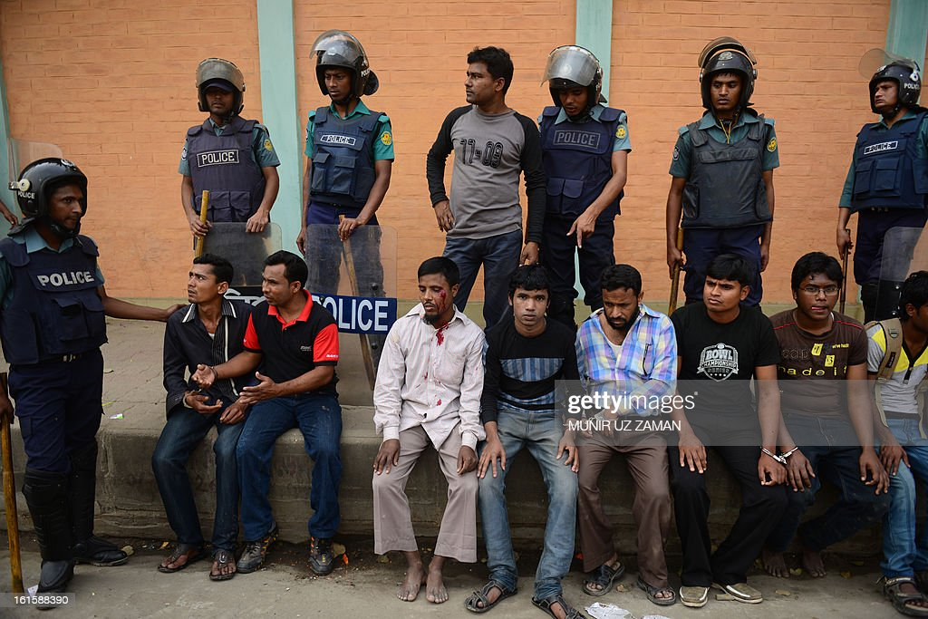 Bangladeshi police detain Jamaat-e-Islami activists during a protest in Dhaka on February 12, 2013. The protesters hurled home-made bombs and attacked vehicles with bricks as police fought back with rubber bullets and tear gas in Dhaka's busy Karwan Bazaar and Motijheel commercial districts, police and witnesses said. AFP PHOTO/ Munir uz ZAMAN