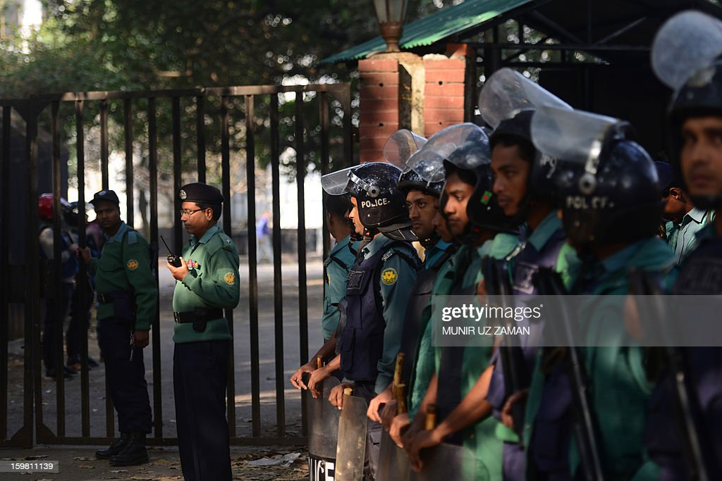 Bangladeshi police keep watch outside the International Crimes Tribunal court premises in Dhaka on January 21, 2013. Bangladesh's controversial war crimes court sentenced to death a top Islamic televangelists for genocide and other atrocities during the country's 1971 liberation struggle against Pakistan, a prosecutor said. Maolana Abul Kalam Azad who has been on the run for about a year is the first person to have been convicted by the controversial International Crimes Tribunal, created by the country's secular government to try suspected war criminals. AFP PHOTO/Munir uz ZAMAN