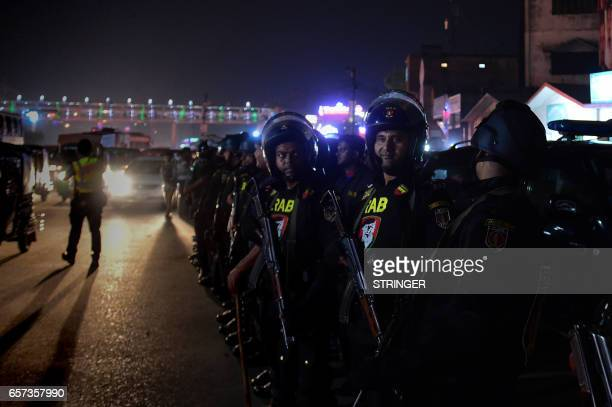 Bangladeshi police officers stand guard after a bomber was killed in a blast in front of a police checkpoint at Dhakas international airport on March...
