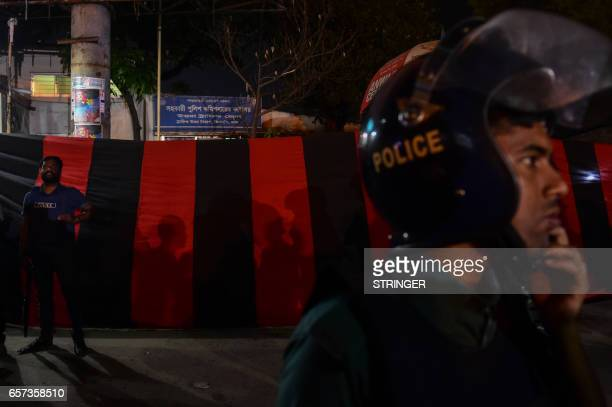 Bangladeshi police officers stand guard after an bomber was killed in a blast in front of a police checkpoint at Dhakas international airport on...