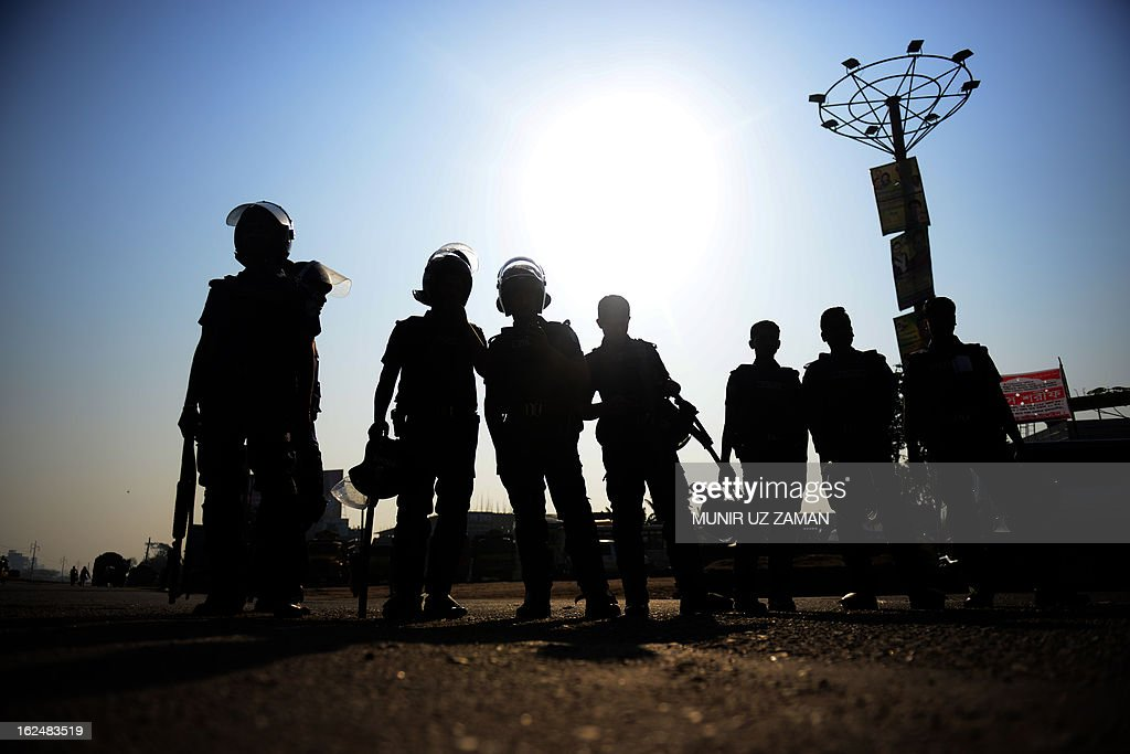 Bangladeshi police personnel stand guard during a nationwide strike in Dhaka on February 24, 2013. The Islamist parties called for a nationwide dawn-to-dusk shutdown on Sunday protesting attacks on demonstrators who were demanding punishment against the 'atheist' bloggers of the Shahbagh movement. AFP PHOTO/Munir uz ZAMAN