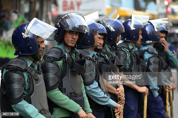 Bangladeshi police stand guard during a nationwide strike called by the Bangladesh Nationalist Party led alliance in Dhaka on January 25 2015...