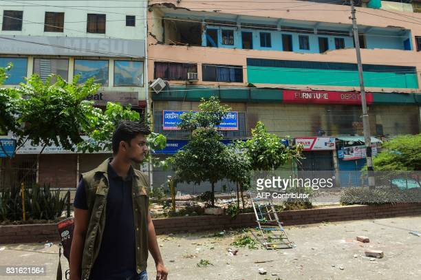 Bangladeshi police stand guard in front of a hotel building after a raid on a militant hideout in Dhaka on August 15 2017 An Islamist extremist was...