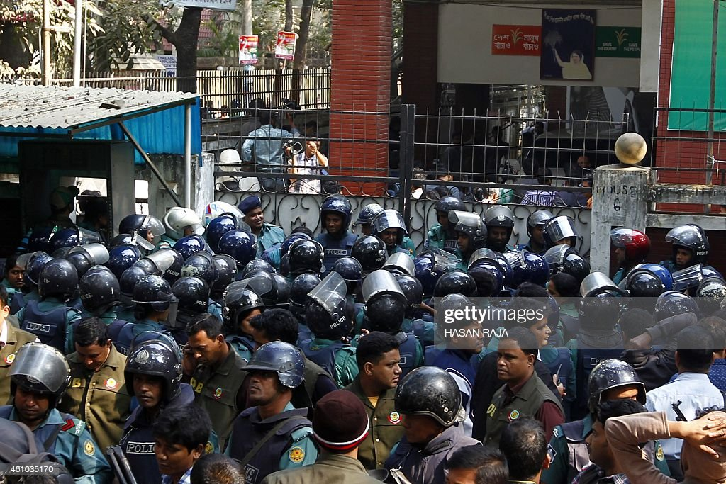 Bangladeshi policemen block the entrance leading to the office of opposition leader <a gi-track='captionPersonalityLinkClicked' href=/galleries/search?phrase=Khaleda+Zia&family=editorial&specificpeople=647544 ng-click='$event.stopPropagation()'>Khaleda Zia</a> in Dhaka on January 5, 2015. Violence broke out across Bangladesh as two opposition activists were shot dead in clashes with ruling party supporters after the main opposition leader called for protests on the first anniversary of controversial elections.