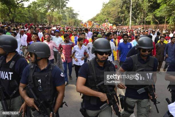 Bangladeshi policemen escort a procession by people to celebrate the first day of the Bangla New Year or quotPahela Baisshakhquot in Dhaka Bangladesh...
