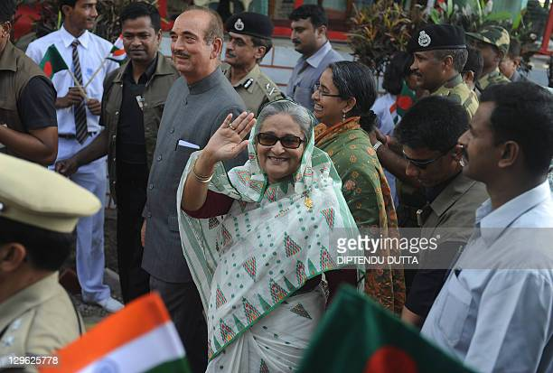 Bangladeshi Prime Minister Sheikh Hasina is welcomed by Indian Union Health Minsiter Ghulam Nabi Azad after her arrival at the Tin Bigha Corridor...