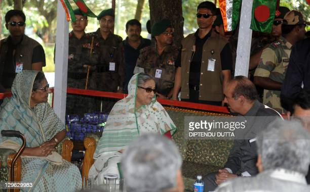 Bangladeshi Prime Minister Sheikh Hasina speaks with Indian Union Health Minister Ghulam Nabi Azad after her arrival at the Tin Bigha Corridor which...